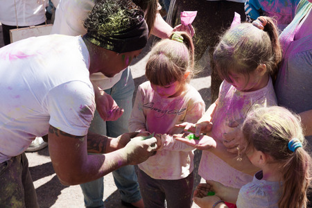 BARCELONA, SPAIN - APRIL 6, 2014: Family with colors at Festival Holi