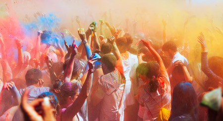 spring festival: BARCELONA, SPAIN - APRIL 6, 2014: Crowd at Festival Holi in Barcelona. It is traditional holiday of Indian Culture Editorial