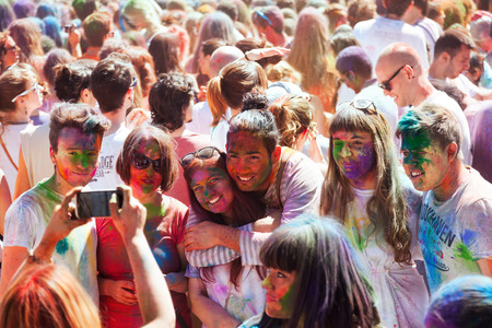 colores: BARCELONA, SPAIN - APRIL 6, 2014: People at IV Festival de los colores Holi Barcelona. Holi is  holiday of Indian Culture