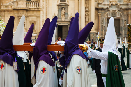 semana santa: MURCIA, SPAIN - APRIL 15, 2014: Holy Week in Spain. Holy Week is   commemoration by Christian religious brotherhoods, processions on  streets of Spanish city