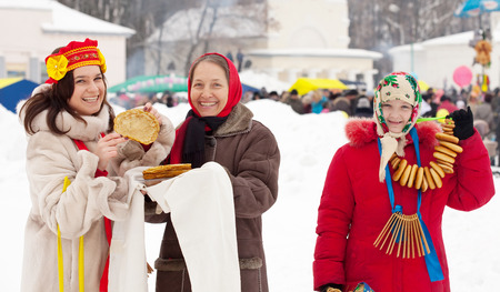 cuisine entertainment: Smiling woman tasting pancake  during  Shrovetide at Russia Stock Photo