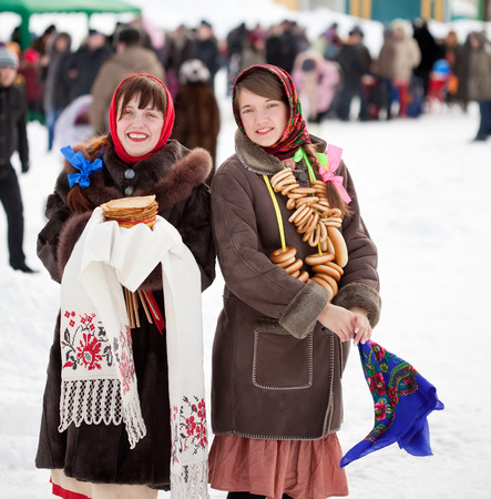 Two happy girls celebrating  Shrovetide  at Russia Stock Photo - 29092916