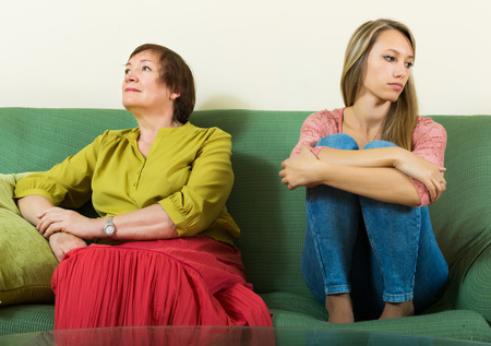 fracas: Sad young woman and  mature mother after conflict  at home