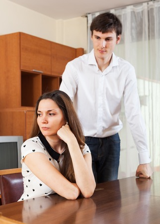conflicting: Young girl conflicting with boyfriend at home