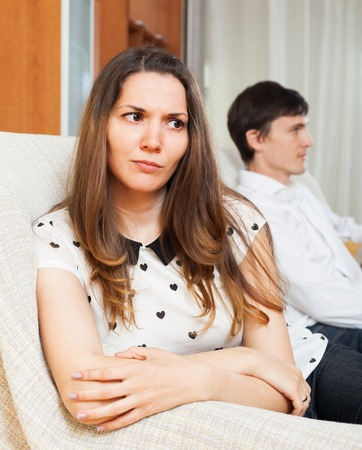 conflicting: Dissapointed girl conflicting with boyfriend at home Stock Photo