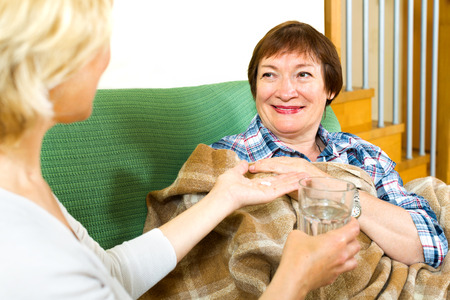 soporific: Medical employee caring for an elderly woman at home