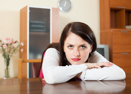 aloneness:  lonely sad brunette woman at  home