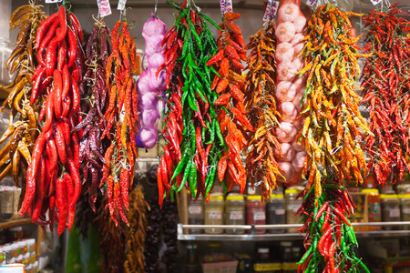 Bundles of red pepper and garlic hanging in spanish market photo