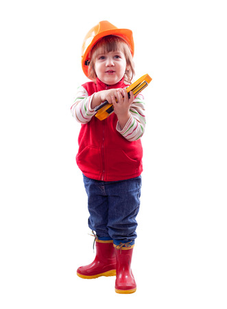 two-year child in hardhat with tools. Isolated over white photo
