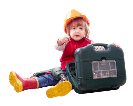 child in hardhat with drill and toolbox. Isolated over white background    photo