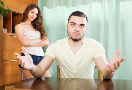 adult rape: Young family  having quarrel at home Stock Photo