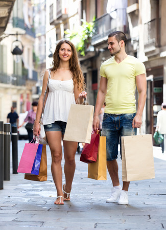 Happy couple  hunting after souvenirs in shopping tour photo