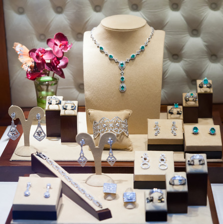 bijouterie: silver jewelry at showcase of jewelry store