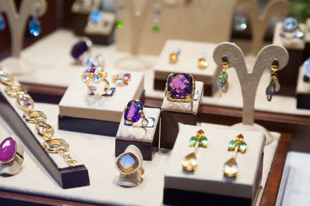 14k: Gold rings with gems on jewelry counter  in store