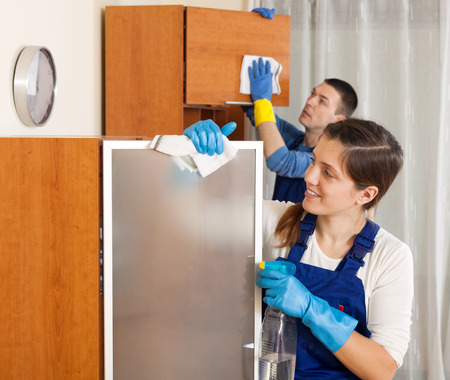 company premises: Professional cleaners cleaning in living room