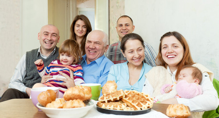 Portrait of happy multigeneration family communicate around tea table at home Stock Photo - 29925933