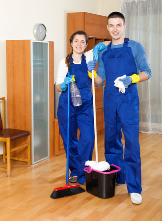 company premises: Man and woman cleaning in room at home