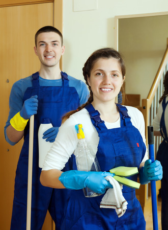 Professional cleaners with equipment ready for work photo