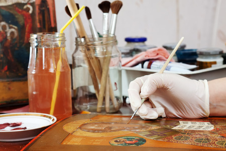 restoration of ancient icon in workshop photo