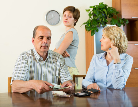 daughter in law: Upset daughter in law asking parents for pocket money Stock Photo