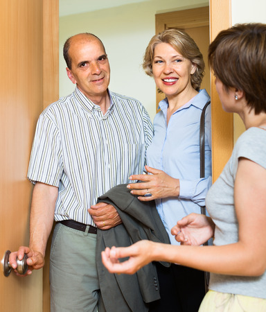 Happy senior family couple visiting daughter at home photo
