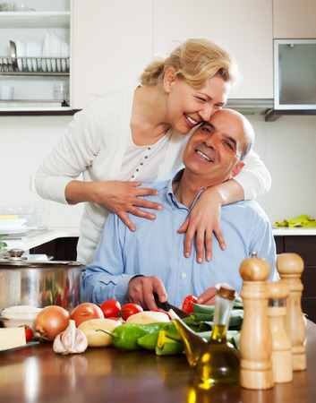 happy family cooking together at home photo