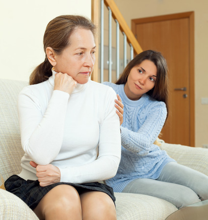 Teenager tries reconcile with her mother after conflict. Focus on mature woman Stock Photo - 30024049