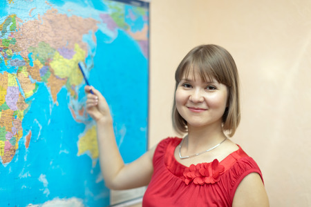 eastward: Woman shows something on the worldmap at house