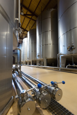 stell: Rows of contemporary stell barrels in winery