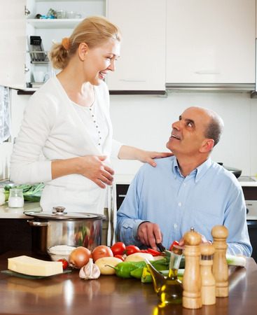 happy family cooking vegetables at home  Stock Photo