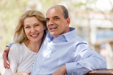 Happy mature couple together in summer park Standard-Bild