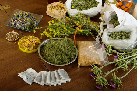 concoct: dried herbs at table in home ready for brews