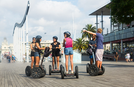 segway: BARCELONA, SPAIN - JULY 6, 2014: Tourists during Segway tour of Barcelona, Spain