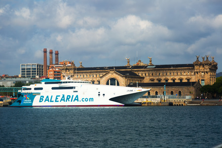 seabus: BARCELONA, SPAIN - JULY 6, 2014: Catamaran ferry at Port Vell.  Barcelona, Spain