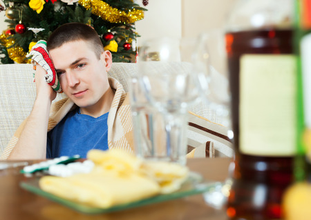 cephalgia: Man having hangover after  celebrating of New year Stock Photo