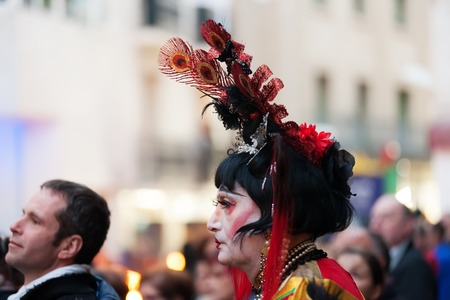 mummery: SITGES, SPAIN - MARCH 5, 2014: Unidentified person at procession of burial Carnestoltes  - Burial of the Sardine at Sitges in evening Editorial