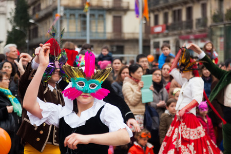 mummery:  BARCELONA, SPAIN - MARCH 2, 2014: Dancing people at Carnival Balls at Placa Comercial Editorial