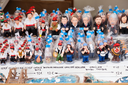 defecation: BARCELONA, SPAIN - DECEMBER 12: Modern caricature catalan caganers on counter of Christmas market on December 12, 2013 in Barcelona, Spain Editorial