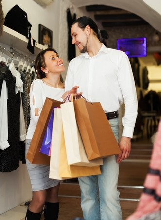 Happy family with shopping bags at fasion store photo