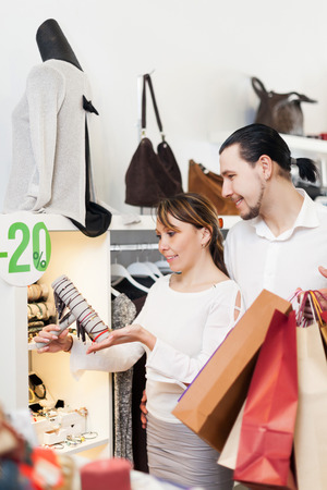 couple with bags  choosing  bracelet at  shop photo