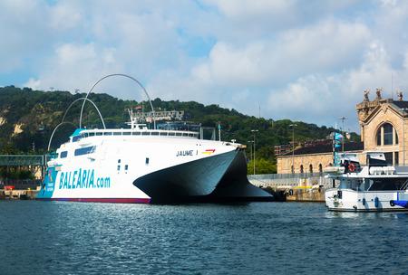seabus: BARCELONA, SPAIN - JULY 6, 2014: Catamaran ferry at Port Vell.  Barcelona