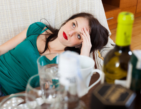 cephalgia: Woman having hangover after celebrating of holiday Stock Photo
