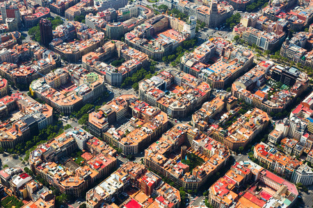 Aerial view  of  residence districts in european city. Eixample  district. Barcelona,  Spain Фото со стока