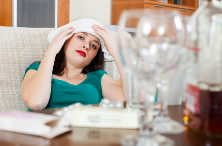 after the party: Woman having headache in morning after party