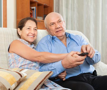 tele: Portrait of joyful married couple in home interior