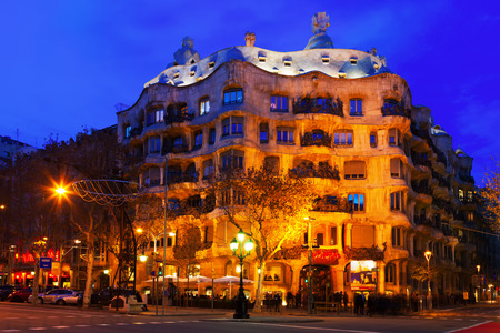 BARCELONA, SPAIN - JANUARY 2, 2014: Night view of Casa Mila in Barcelona. House was built in 1905–1910 by Catalan architect Antoni Gaudi