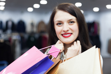 ordinary woman: Portrait of ordinary woman with shopping bags Stock Photo