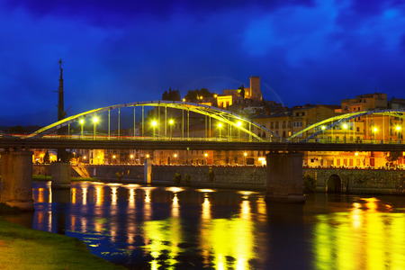 ebre: Evening view of Pont de lEstat over Ebro river  and Suda Castle in Tortosa, Spain