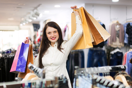 prety: Prety young woman with a lot of shopping bags at fashionable store