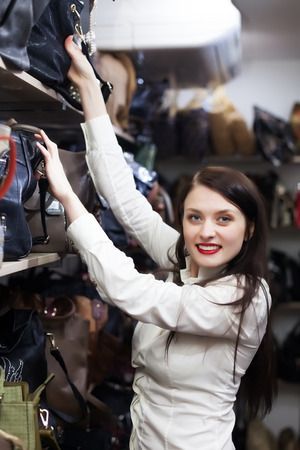 ordinary woman: Ordinary woman choosing leather bag at store
